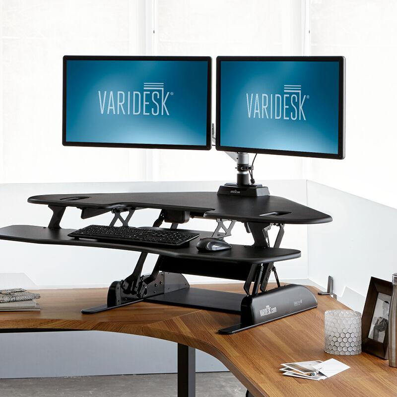 VariDesk Cube Corner 48 Black sit-stand desk converter in raised position in office  image number null