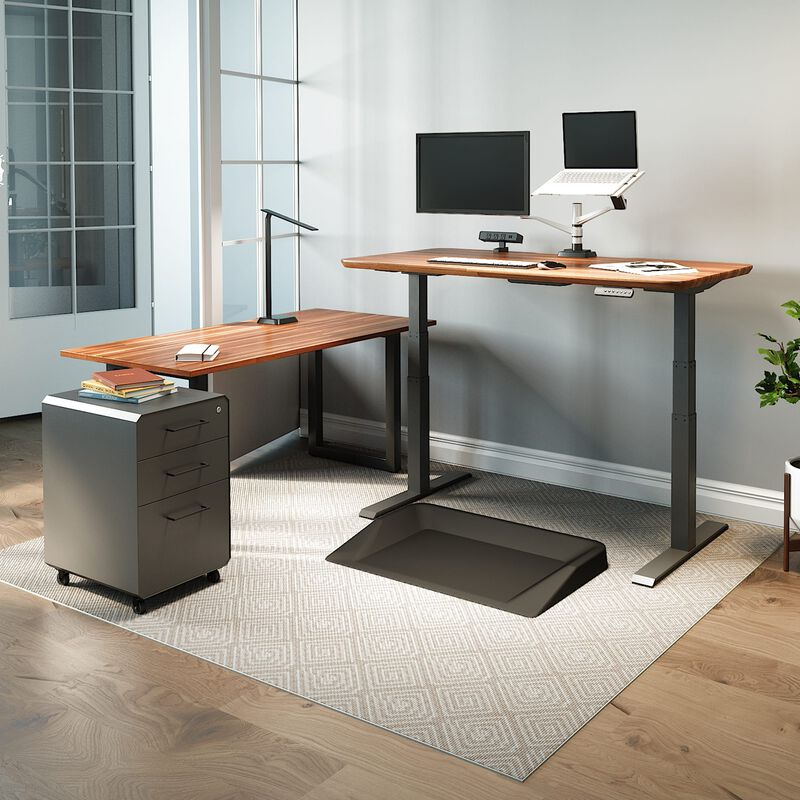 vari electric standing desk, table, and accessories in home office image number null