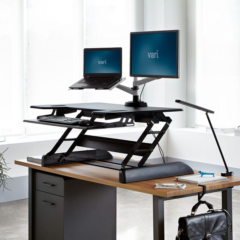 VariDesk® Tall 40 Black in raised position at office image number null