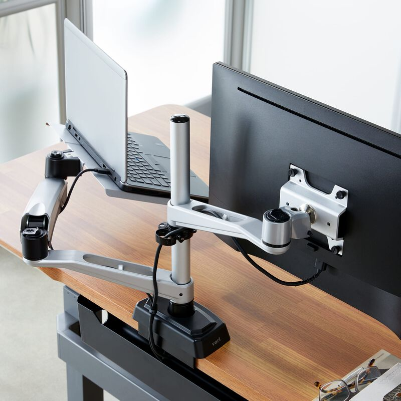 Overhead view of Monitor Arm + Laptop Stand mounted to desk with one monitor and laptop image number null