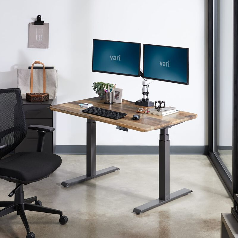 Electric Standing Desk 48x30 Reclaimed Wood in lowered position at office image number null