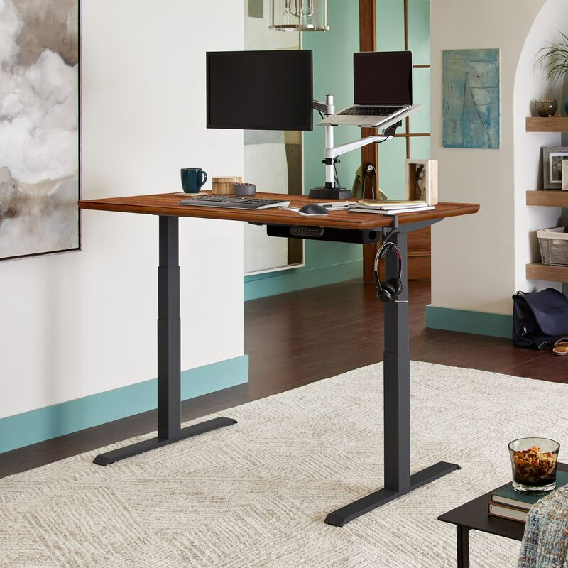 Electric Standing Desk 60x30 Dark Wood in raised position at home image number null