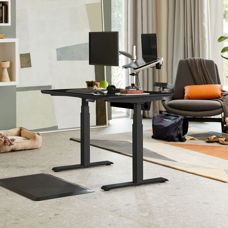 Electric Standing Desk 48x30 Black in lowered position at home image number null