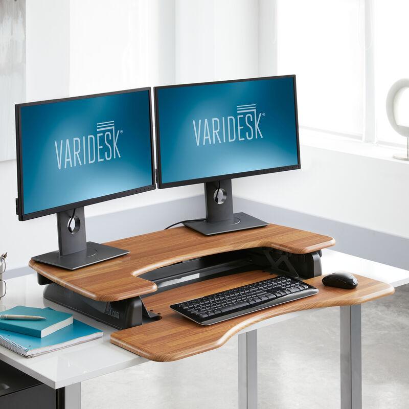VariDesk Pro Plus 36 Butcher Block sit-stand desk converter lowered in office  image number null