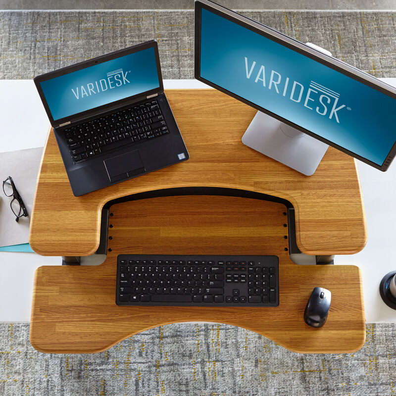 Overhead view of the VariDesk Pro Plus 36 Butcher Block sit-stand desk converter lowered on a wooden desk image number null