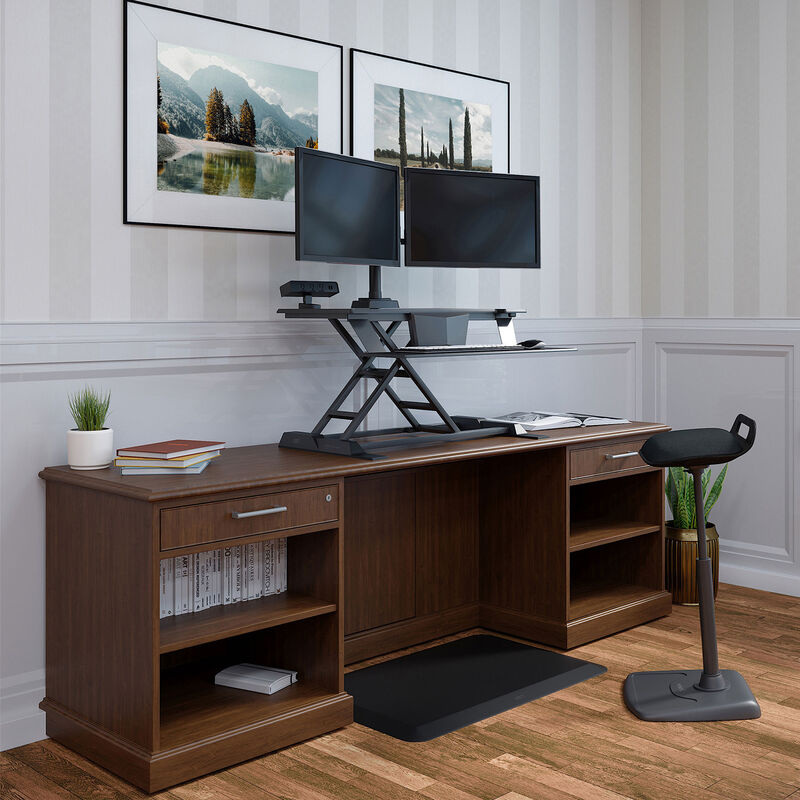 Electric standing desk converter ontop of wood desk in home office image number null
