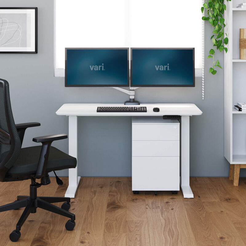 vari essential electric standing desk in office setting image number null