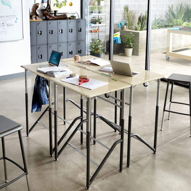 Four Standing School Desks 5-12 Maple grouped together in classroom at schooll image number null