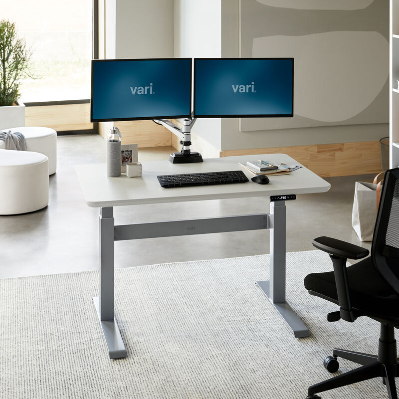 Electric Standing Desk 48x30 White in lowered position at office image number null