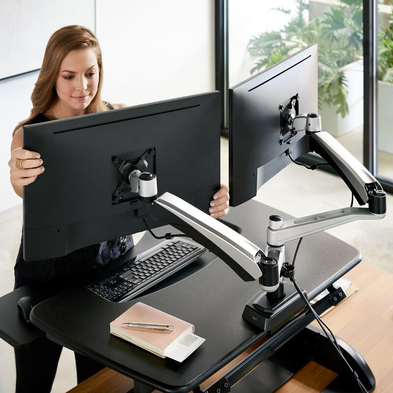 Woman adjusting Dual-Monitor Arm stand image number null