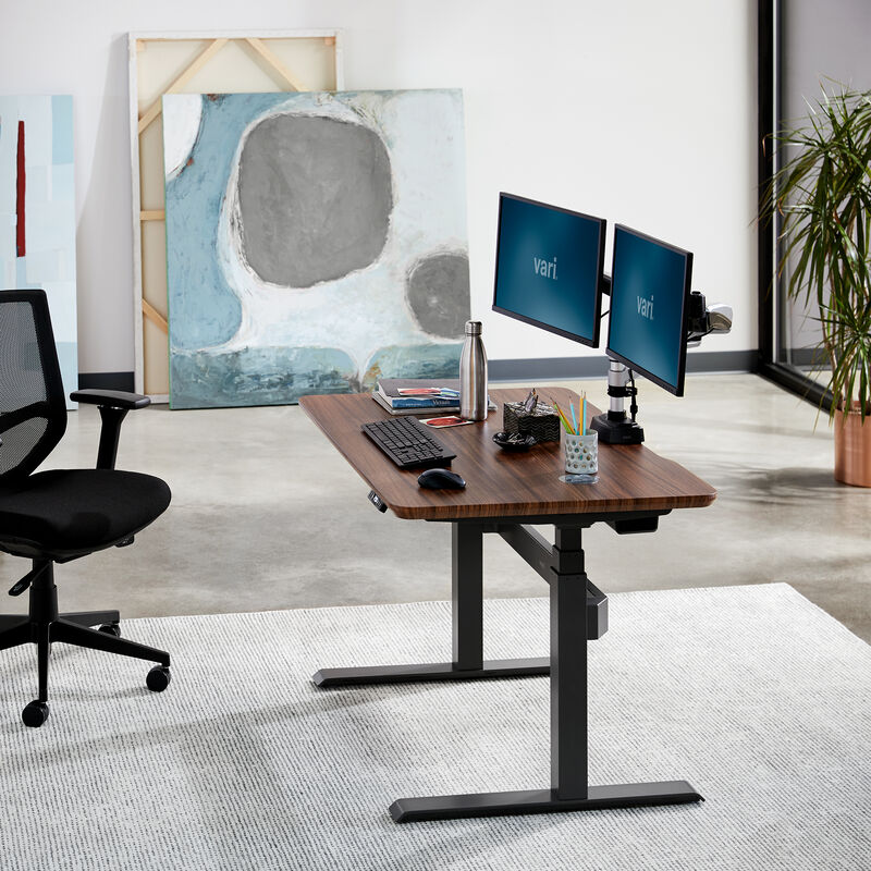 Electric Standing Desk 48x30 Darkwood in lowered position at office image number null