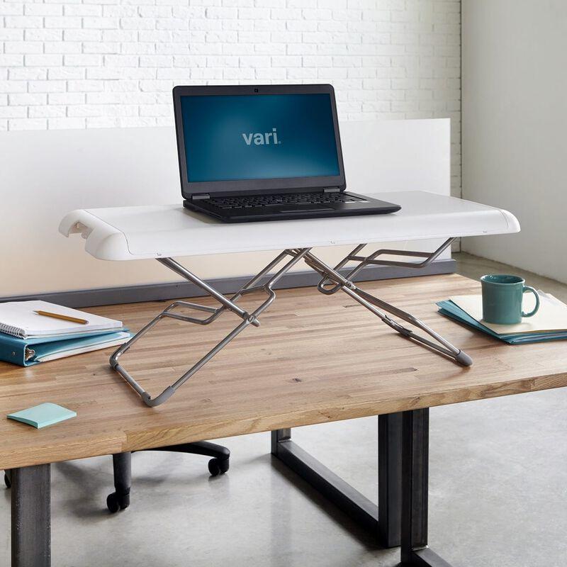 VariDesk Soho in white raised on existing desk in office image number null