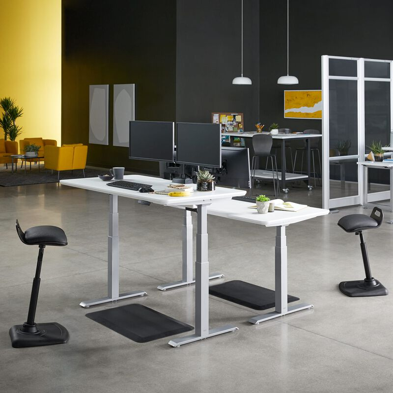 Electric Standing Desk 60x30 White in lowered position at office image number null