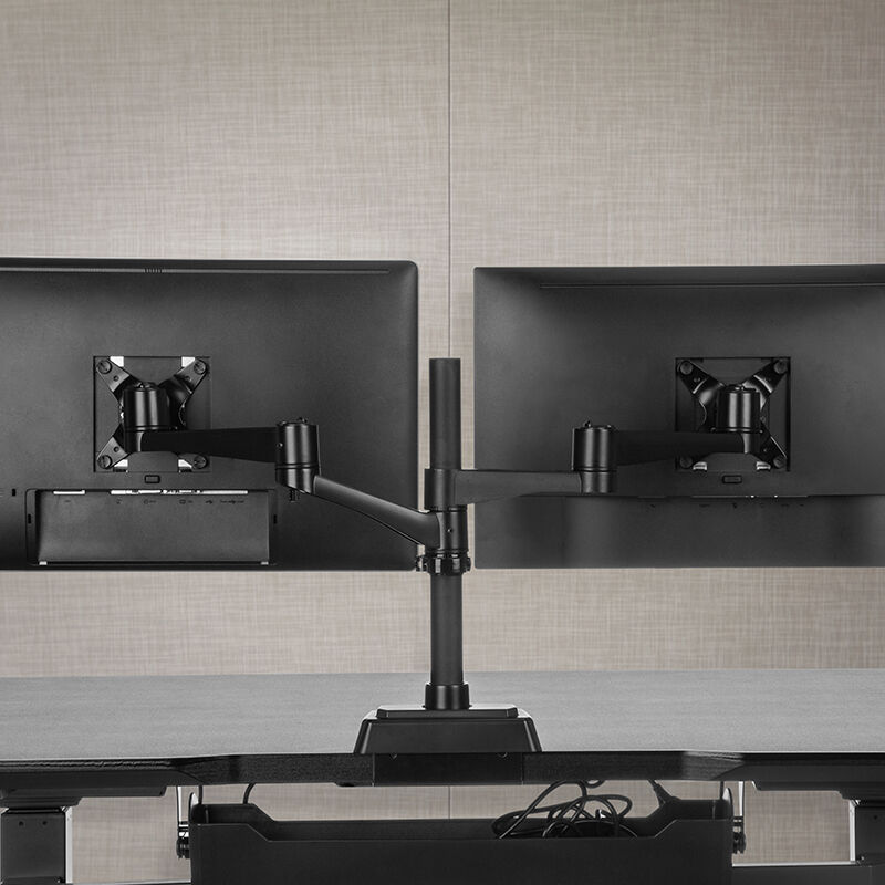 Dual-Monitor Arm 180° Black mounted to desk with two monitors installed image number null