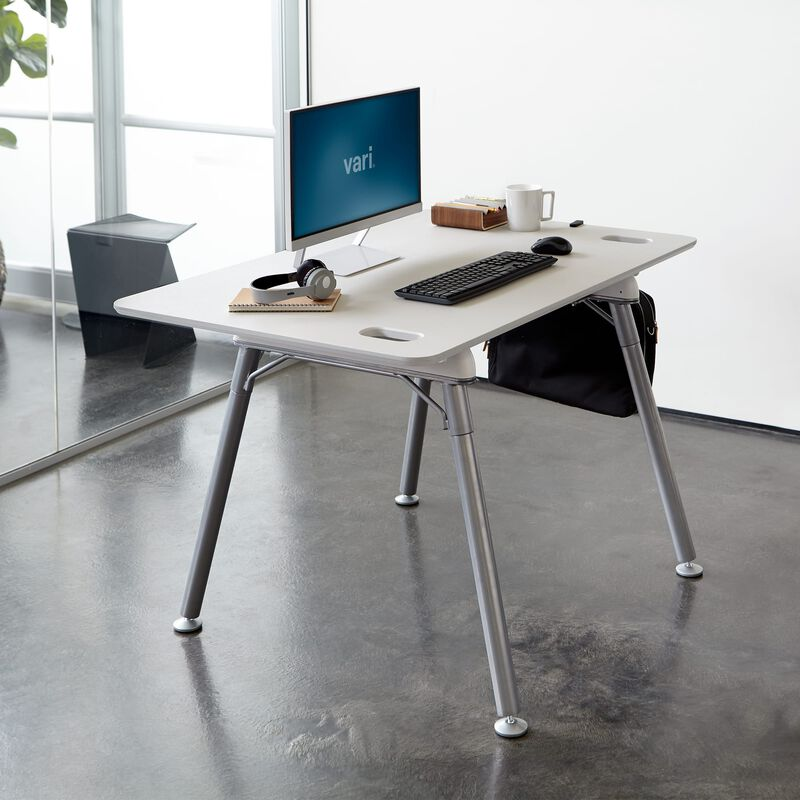 Standing Desk 48x32 White in lowered position at office image number null