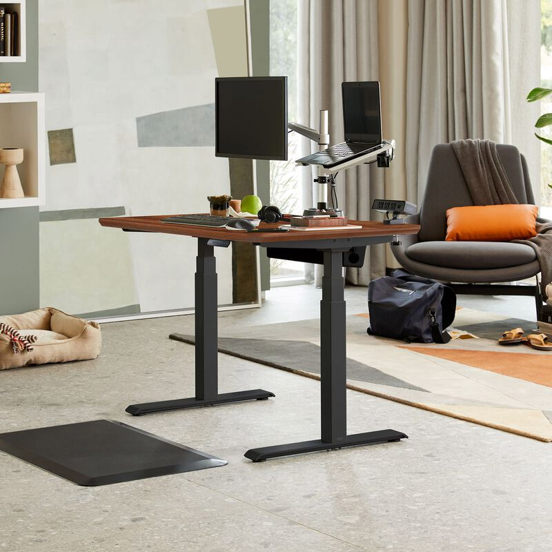 Electric Standing Desk 48x30 Darkwood in raised position at home image number null