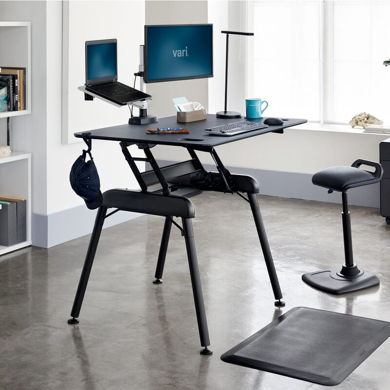 Standing Desk 48x32 Black in raised position at office image number null