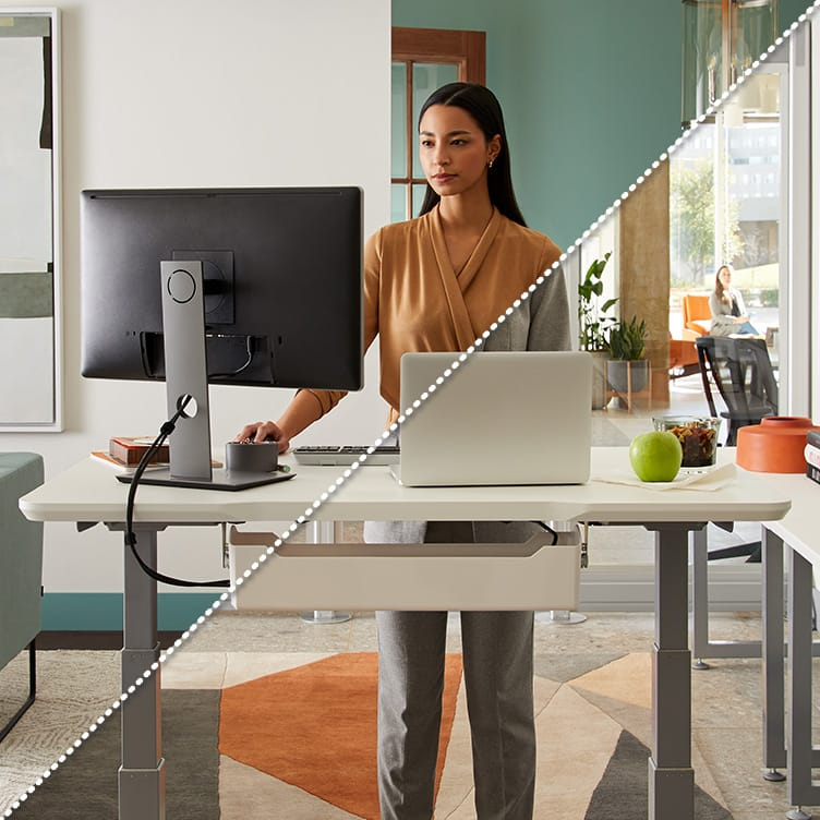 professional working at electric standing desk