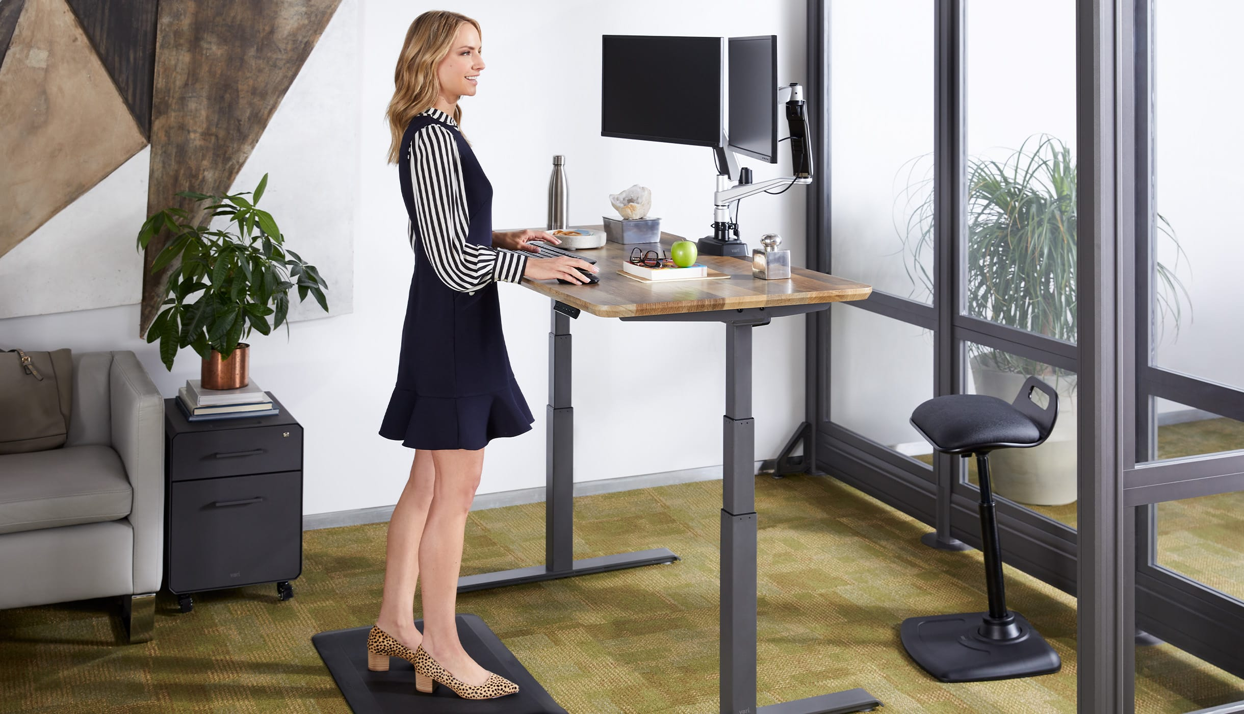 professional working in private office complete with the mentioned accessories