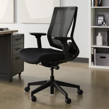 vari task chair in office setting next to table
