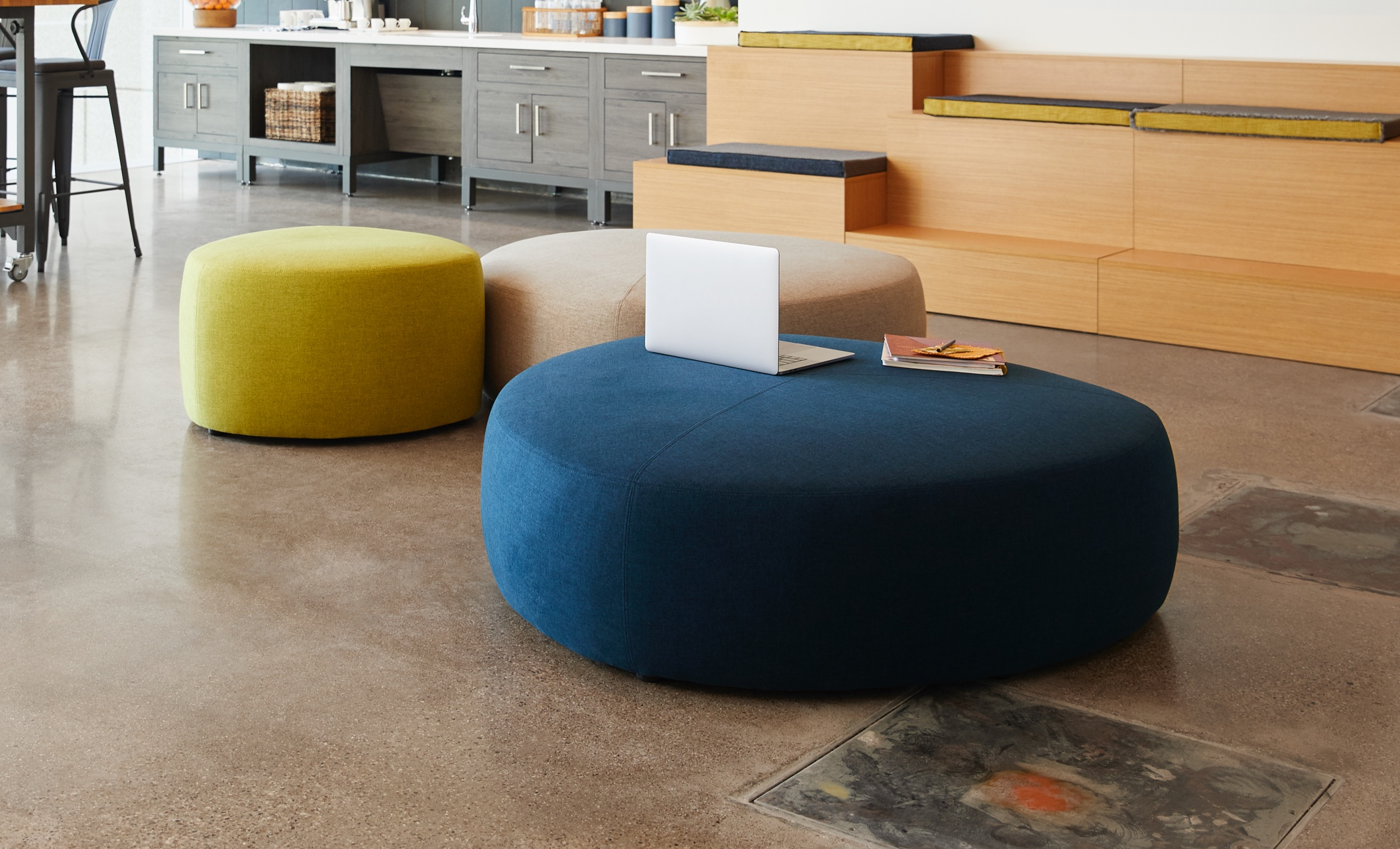 two large ottomans and one small ottoman appear in office setting