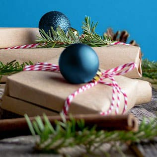 gift wrapped packages with holiday ornaments
