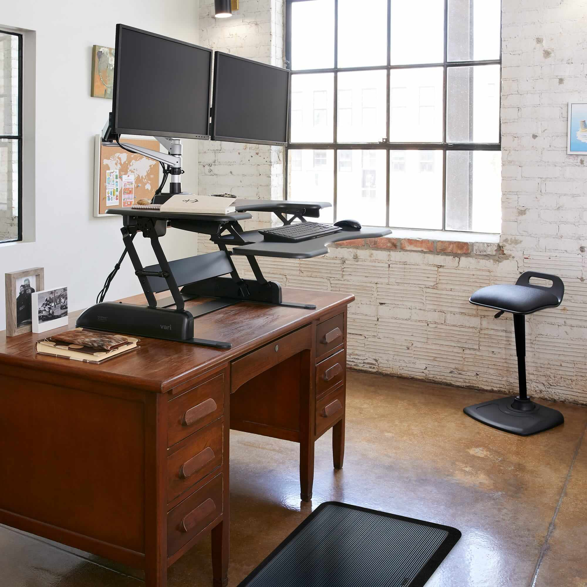 home office with varidesk height-adjustable converter on top of existing wooden desk